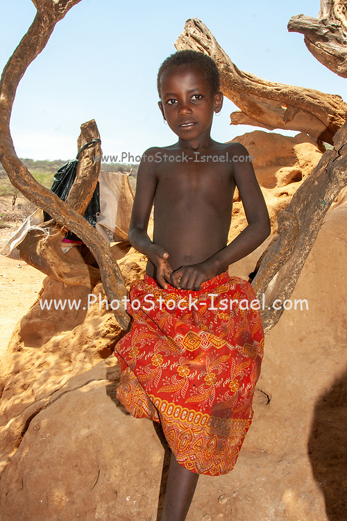 Young boy of the Samburu tribe. The Samburu are a Nilotic people of north-central Kenya. Samburu are semi-nomadic pastoralists who herd mainly cattle but also keep sheep, goats and camels.