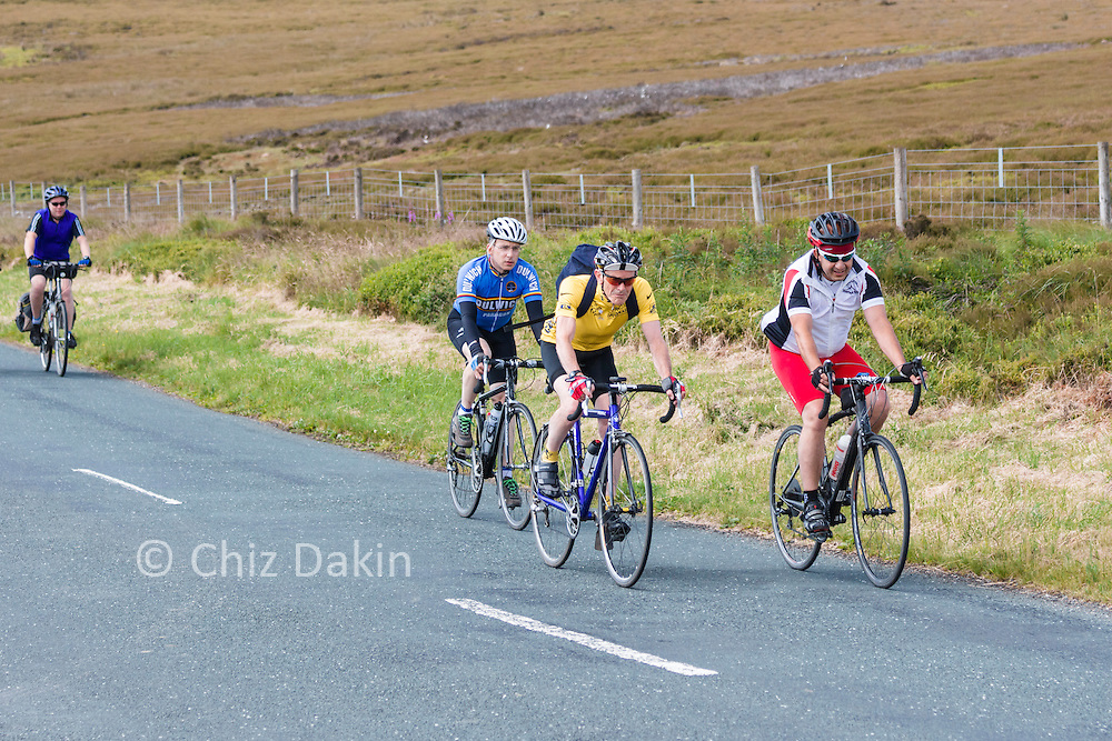 Cyclists riding to watch the Tour de France in the Peak District
