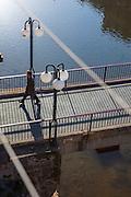 Man walking on the Pont de Sant Agustí, Girona, Catalonia, Spain