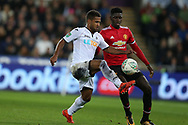 Wayne Routledge of Swansea city  is challenged by Axel Tuanzebe of Manchester Utd ®. EFL Carabao Cup 4th round match, Swansea city v Manchester Utd at the Liberty Stadium in Swansea, South Wales on Tuesday 24th October 2017.<br /> pic by  Andrew Orchard, Andrew Orchard sports photography.