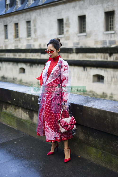 March 4, 2018 - Paris, France - Aimee Song poses wearing a Burberry trench coat and Valentino dress and bag after the Valentino show at Les Invalides during Paris Fashion Week Womenswear FW 18/19 on March 4, 2018 in Paris, France. (Credit Image: © Nataliya Petrova/NurPhoto via ZUMA Press)