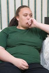 Teenage girl watching Television,