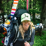 Portrait of professional free skier Lynsey Dyer with loaded backpack.