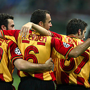Arif Erdem (C) of Galatasaray gives the thumbs up after scoring against Lokomotiv Moscow as he celebrates with team mates Hakan Unsal (L) and Ergun Penbe during their Group H Champions League soccer match in Moscow's Lokomotiv stadium September 18, 2002. Galatasaray won the match 2-0. REUTERS/Grigory Dukor REUTERS