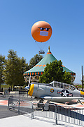 The Orange County Great Park Balloon Ride with COVID-19 Face Mask Rises over the Carousel Ride and Plane Exhibit