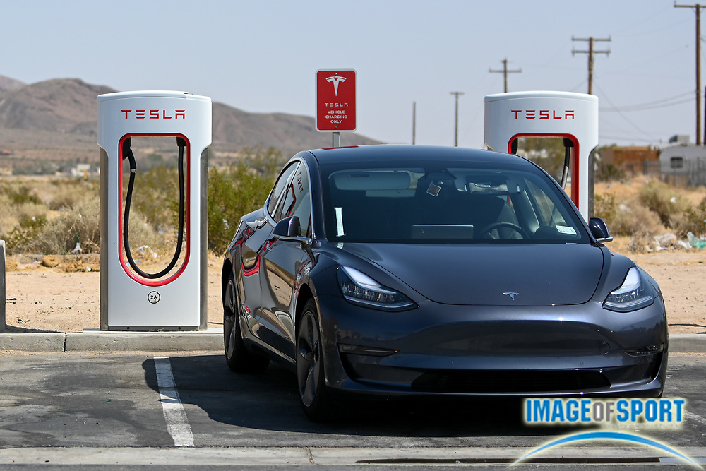 A Tesla Model 3 is seen charging at a Super Charger at EddieWorld on Monday, Sept. 21, 2020, in Yermo, Calif. (Dylan Stewart/Image of Sport)