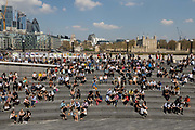 Crowds of office workers and tourists at lunchtime sit in the Scoop on the South Bank seen in front of City of London skyscrapers and the Tower of London during hot and sunny weather on April 20, 2018 in London, England. Yesterday the United Kingdom experienced the hottest day in April since 1949, with temperatures reaching 27.9C 82.2F in London.
