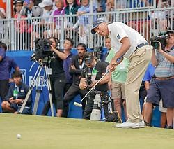 January 13, 2019 - Honolulu, HI, U.S. - HONOLULU, HI - JANUARY 13: Matt Kuchar follows his putt on the 18th green during the final round of the Sony Open at the Waialae Country Club in Honolulu, HI. (Photo by Darryl Oumi/Icon Sportswire) (Credit Image: © Darryl Oumi/Icon SMI via ZUMA Press)
