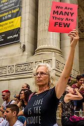 August 14, 2017 - New York, New York, United States - In the wake of the horrific events of the past week, Activists took to the streets after Trump stokes fears with careless words and tactics. Members of Rise and Resist and concerned residents, organized a march on August 14, 2017; from the main branch of the New York Public Library to the Trump International Hotel near Columbus Circle with signs conveying simple messages to Trump and the GOP – no war, deescalate immediately, and be proactive in ending racism in the U.S. (Credit Image: © Erik Mcgregor/Pacific Press via ZUMA Wire)