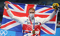 TOKYO, JAPAN - JULY 27: Tom Dean of Great Britain poses with his gold medal after winning the Men's 200m Freestyle final on day four of the Tokyo 2020 Olympic Games at Tokyo Aquatics Centre on July 27, 2021 in Tokyo, Japan. <br /> <br /> Credit: COLORSPORT/Ian MacNicol