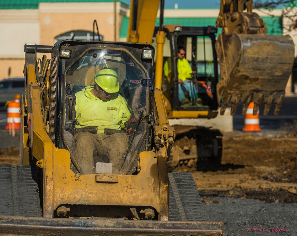 Workers dig up the parking lot and lay groundwork for new construction in the MacArthur Commons parking lot in the 2000 block of MacArthur Road in Whitehall Twp., Lehigh County, Pa.. Picture made November 26, 2019. Donna Fisher Photography, LLC