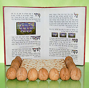 Pesach (Passover) concept image with Haggadah, Matzah and nuts