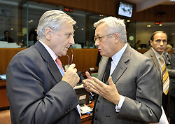 Jean-Claude Trichet, president of the European Central Bank, left, speaks with Giulio Tremonti, Italy's finance minister, during ECOFIN, the meeting of EU finance ministers, at the European Council headquarters in Brussels, Belgium, on Tuesday, Nov. 10, 2009. (Photo © Jock Fistick)
