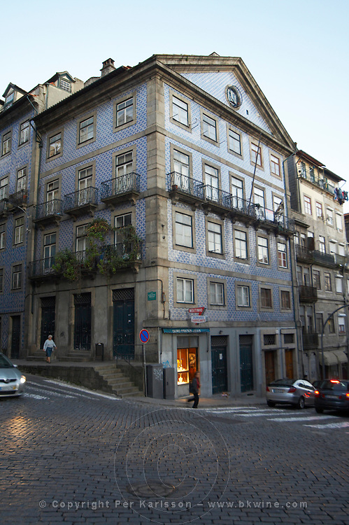 a house covered in blue azulejo tiles praca do infante dom henrique porto portugal