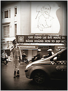 Officer directs traffic at a busy intersecion in downtown Hanoi, Vietnam, Southeast Asia