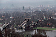 GER_21_xs.Dresden, East Germany. View of the Elbe River bridge with smoky city. 1983..