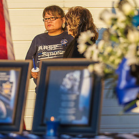 Tamarra Largo, left, and Beth Miller, right, comfort each other behind the display set up in honor Officer Houston Largo, Monday at a vigil held at the Gallup Police Department in Gallup. Largo was Houston's sister and Miller was his aunt. Officer Largo was killed in the line of duty March 12, 2017.