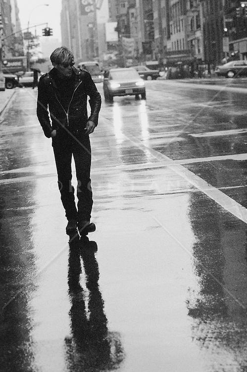 Man walking in the rain on a street in New York City