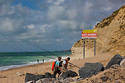 Anglers on the  beach at Bidart, Biarritz, Basque Country, France