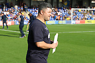 AFC Wimbledon first team coach Simon Bassey walking onto pitch during the EFL Sky Bet League 1 match between AFC Wimbledon and Portsmouth at the Cherry Red Records Stadium, Kingston, England on 13 October 2018.