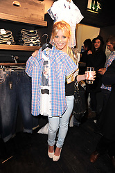 MOLLIE KING from The Saturdays at the Lee store re-launch party held at 13-14 Carnaby Street, London on 31st March 2010. MOLLIE KING