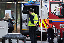 © Licensed to London News Pictures . 18/04/2018. Manchester, UK. A large metal container is placed in to the back of a police van at the scene . Buildings are evacuated and streets closed off by police amid reports of a chemical spill at a building belonging to the Manchester Institute of Biotechnology on Princess Street in Manchester City Centre . Photo credit : Joel Goodman/LNP