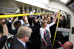 21 April 2011. London, England..London underground, the Tube. Packed with workers returning home from work and tourists in town for the Royal wedding..Photo; Charlie Varley.