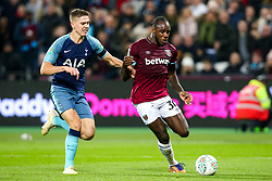 Michail Antonio of West Ham United goes past Juan Foyth of Tottenham Hotspur - Mandatory by-line: Robbie Stephenson/JMP - 31/10/2018 - FOOTBALL - London Stadium - London, England - West Ham United v Tottenham Hotspur - Carabao Cup