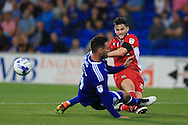 Craig Conway of Blackburn Rovers ® has a shot at goal blocked by Sean Morrison of Cardiff city.EFL Skybet championship match, Cardiff city v Blackburn Rovers at the Cardiff city stadium in Cardiff, South Wales on Wednesday 17th August 2016.<br /> pic by Andrew Orchard, Andrew Orchard sports photography.