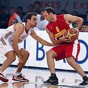 Montenegro's Goran JERETIN (R) and Turkey's Ender ARSLAN (L) during their Istanbul CUP 2011match played Montenegro between Turkey at Abdi Ipekci Arena in Istanbul, Turkey on 25 August 2011. Photo by TURKPIX