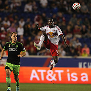 Bradley Wright-Phillips, (right), New York Red Bulls, brings the ball under control while watched by Chad Marshall, Seattle Sounders, during the New York Red Bulls Vs Seattle Sounders, Major League Soccer regular season match at Red Bull Arena, Harrison, New Jersey. USA. 20th September 2014. Photo Tim Clayton