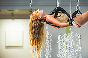 "Performance Artist Millie Brown Millie Brown performs ""Rainbow Body""- a site specific performance installation, where she suspends her body surrounded by crystal prisms, from the ceiling of the gallery on Dover Street for the duration of Frieze one of the busiest weeks in the captial's art scene. Contemporary art gallery Gazelli Art House supports and presents a wide range of international artists."