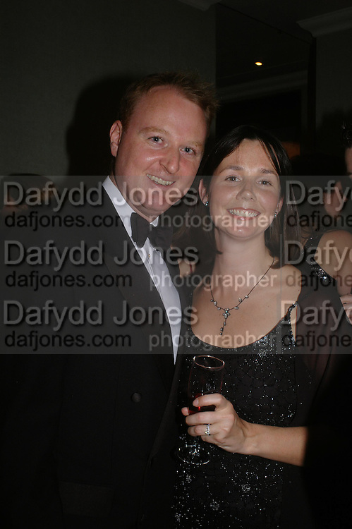 David Stephens ( chairman of Ball)  and his wife. White Knights Ball, Grosvenor House Hotel 7 January 2005. ONE TIME USE ONLY - DO NOT ARCHIVE  © Copyright Photograph by Dafydd Jones 66 Stockwell Park Rd. London SW9 0DA Tel 020 7733 0108 www.dafjones.com
