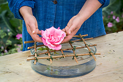 Making bowl of floating roses. Using criss cross noughts and crosses grid to support flowers