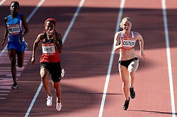 Trinidad and Tobago's Michelle-Lee Ahye (centre) and Northern Ireland's Amy Foster compete in the Women's 100m Round 1 - Heat 4 at the Carrara Stadium during day four of the 2018 Commonwealth Games in the Gold Coast, Australia.