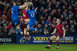 December 30, 2018 - Limerick, Ireland - James Lowe and Rory O'Loughlin of Leinster jump high for the ball with Andrew Conway of Munster during the Guinness PRO14 match between Munster Rugby and Leinster Rugby at Thomond Park in Limerick, Ireland on December 29, 2018  (Credit Image: © Andrew Surma/NurPhoto via ZUMA Press)