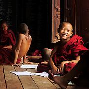 Monks on a Buddhist monastery classroom