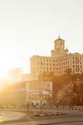 City street, building and tourist at sunset, Havana, Cuba