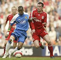 Photo: Aidan Ellis.<br /> Liverpool v Wigan Athletic. The Barclays Premiership. 21/04/2007.<br /> Liverpool's Jamie Carragher (R) challenges Wigan's Henri Camara
