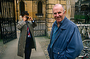 A portrait of Australian-born, Clive James as he is recognised and photographed by a Japanese tourist, on 20th January 1990 in Cambridge UK. Clive James AO CBE FRSL b1939 is an Australian author, critic, broadcaster, poet, translator and memoirist, best known for his autobiographical series Unreliable Memoirs, for his chat shows and documentaries on British television and for his prolific journalism. He has lived and worked in the United Kingdom since 1962.