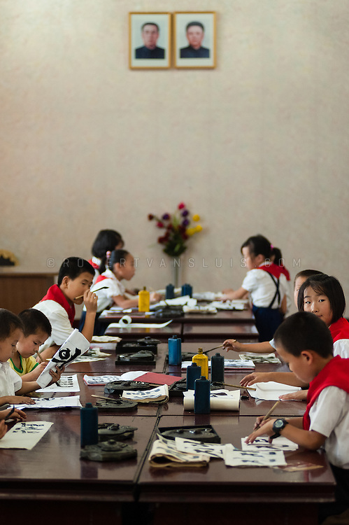 Studying calligraphy at the Students and Children's Palace, Pyongyang, DPRK (North Korea)