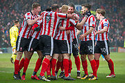 Lincoln celebrate as Lincoln City Forward Matt Green scores a goal 2-0 during the EFL Sky Bet League 2 match between Lincoln City and Grimsby Town FC at Sincil Bank, Lincoln, United Kingdom on 17 March 2018. Picture by Craig Zadoroznyj.