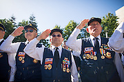 From left to right, Yong Pyon, Paul Jaejeong Yoo, and Bless Chang of the Korean War Veterans Association of Northern California salute during the National Anthem during the Memorial Day Ceremony at Milpitas City Hall's Veterans Plaza in Milpitas, California, on May 26, 2014. (Stan Olszewski/SOSKIphoto)