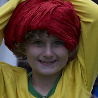 Girl playing dressing up with red indian turban and tilak<br />