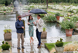 The Duke and Duchess of Cambridge are shown around the White Garden in Kensington Palace, London, during a visit to meet representatives from charities supported by Diana, the Princess of Wales.
