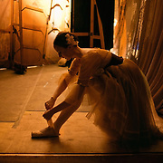 Sonya Lyubimova, a dancer of the famous Bolshoi Ballet troupe, tying her slipper during a performance at the Emirates Palace, Abu Dhabi. During the intensive renovation work at the Bolshoi Theatre, the troupe performed regularly abroad.