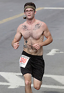 Middletown, New York - A runners competes in the Run4Downtown four-mile road race on Aug. 21, 2010.