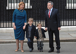 © under license to London News Pictures. LONDON. 05/05/2011. One year on since the last General Election. FILE PICTURE DATED. 11/05/10. Gordon Brown, his wife Sarah, children John and James pose for the media on Downing Street. British Prime Minister Gordon Brown has resigned his position and David Cameron has become the new British Prime Minister on May 11, 2010. The Conservative and Liberal Democrats are to form a coalition government after five days of negotiation. Photo credit should read Stephen Simpson/LNP