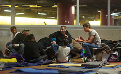 14.09.2015, Hauptbahnhof Salzburg, AUT, Fluechtlinge am Hauptbahnhof Salzburg auf ihrer Reise nach Deutschland, im Bild Flüchtlinge in der Tiergarage // Migrants rest on camp beds at an improvised shelter in the underground parking. Thousands of refugees fleeing violence and persecution in their own countries continue to make their way toward the EU, Main Train Station, Salzburg, Austria on 2015/09/14. EXPA Pictures © 2015, PhotoCredit: EXPA/ JFK