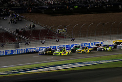 September 14, 2018 - Las Vegas, NV, U.S. - LAS VEGAS, NV - SEPTEMBER 14: Brett Moffitt (16) Toyota Tundra and Matt Crafton (88) Ideal Door, Menards ThorSport Racing Ford F-150 race side-by-side late in the race during the World of Westgate 200 NASCAR Camping World Truck Series Playoff Race on September 14, 2018, at Las Vegas Motor Speedway in Las Vegas, NV. (Photo by David Griffin/Icon Sportswire) (Credit Image: © David Griffin/Icon SMI via ZUMA Press)
